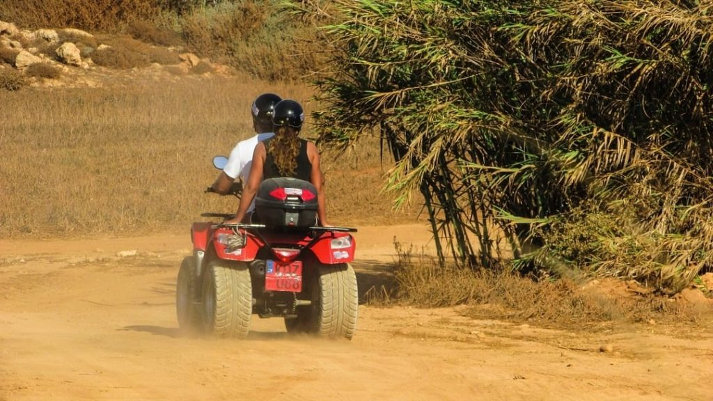 Couple on a quad bike