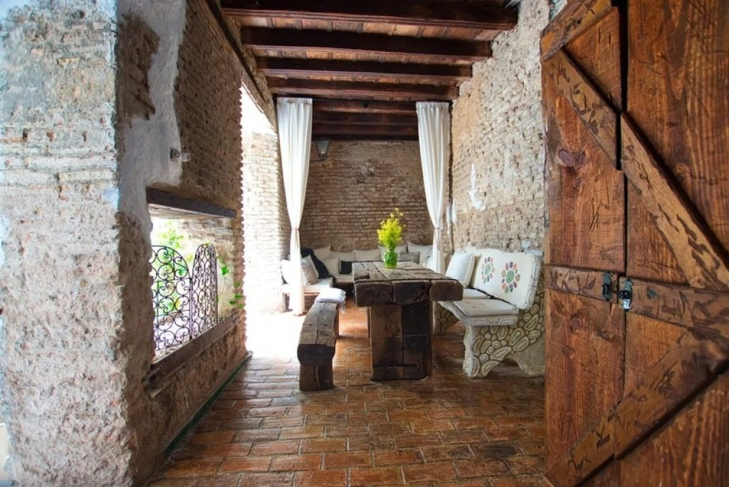 wooden-dinning-table-stone-room-airbnb-seville-spain
