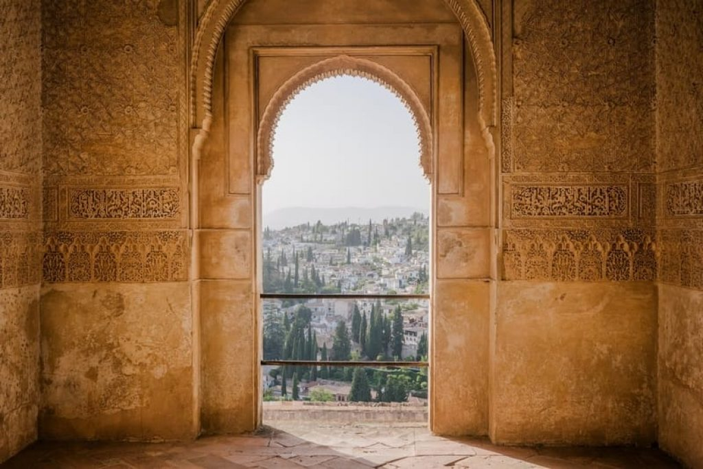 View-of-Granada-through-intricate-arch-in-Alhambra