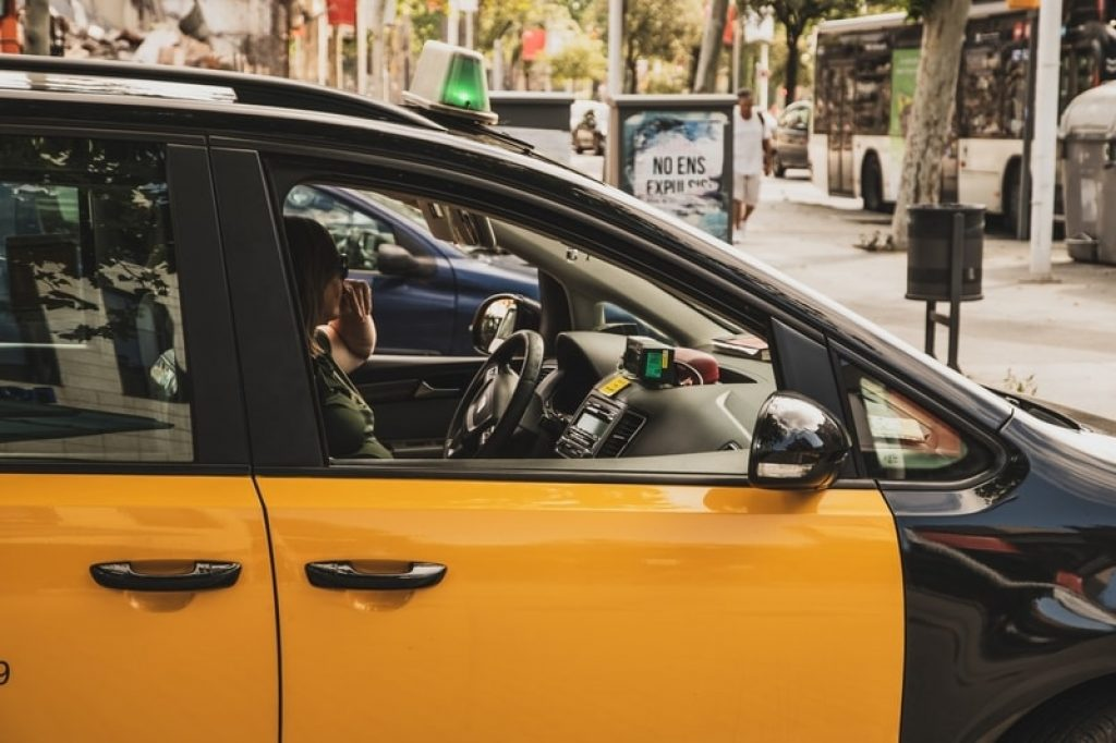 yellow and black taxi cab