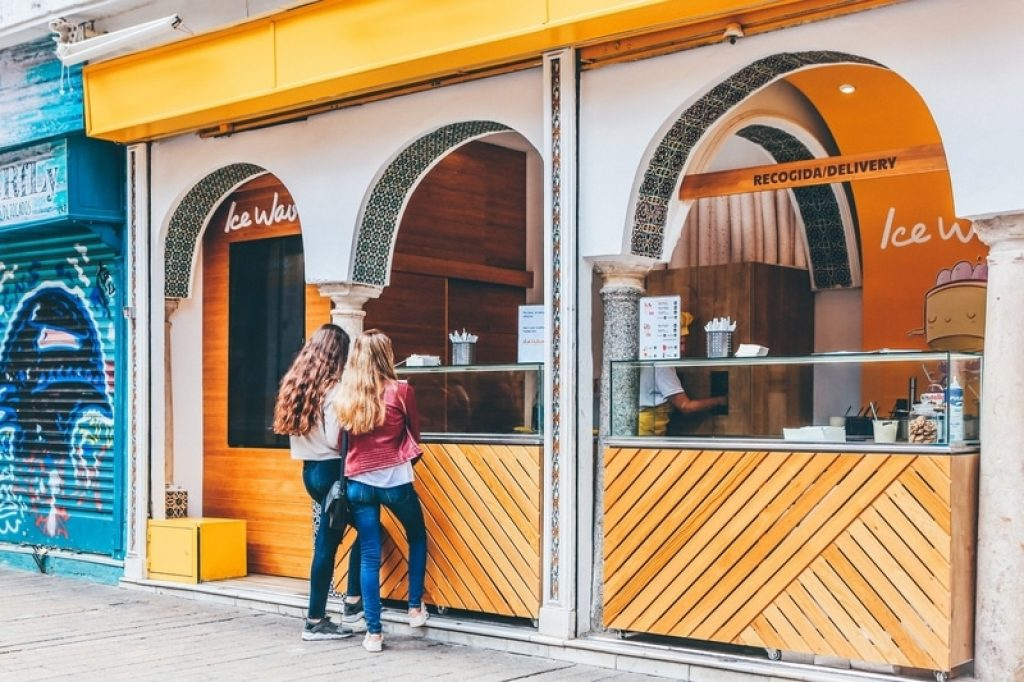 Two ladies standing outside an ice cream shop in spain
